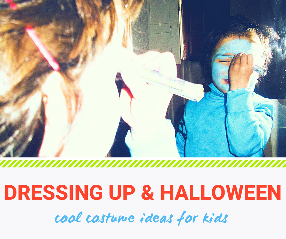 Dressing up and Halloween: cool costume ideas for kids. Little kid in a Smurf costume painting his face blue.