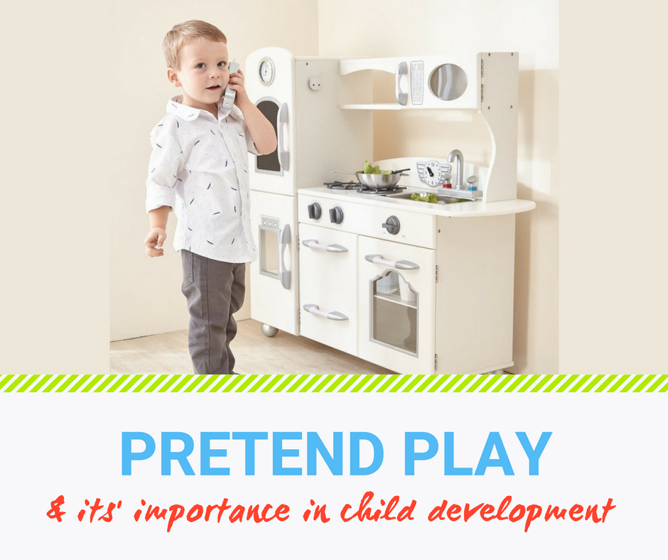 Little toddler boy playing with a white vintage play kitchen - great for pretend play and mental development.